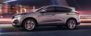 Image of tan 2019 Acura RDX at night.