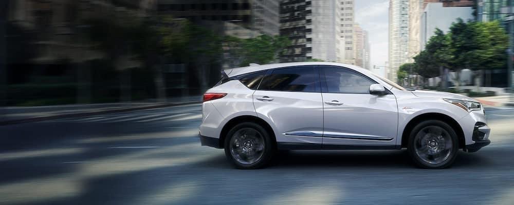 White 2020 Acura RDX Driving Through City