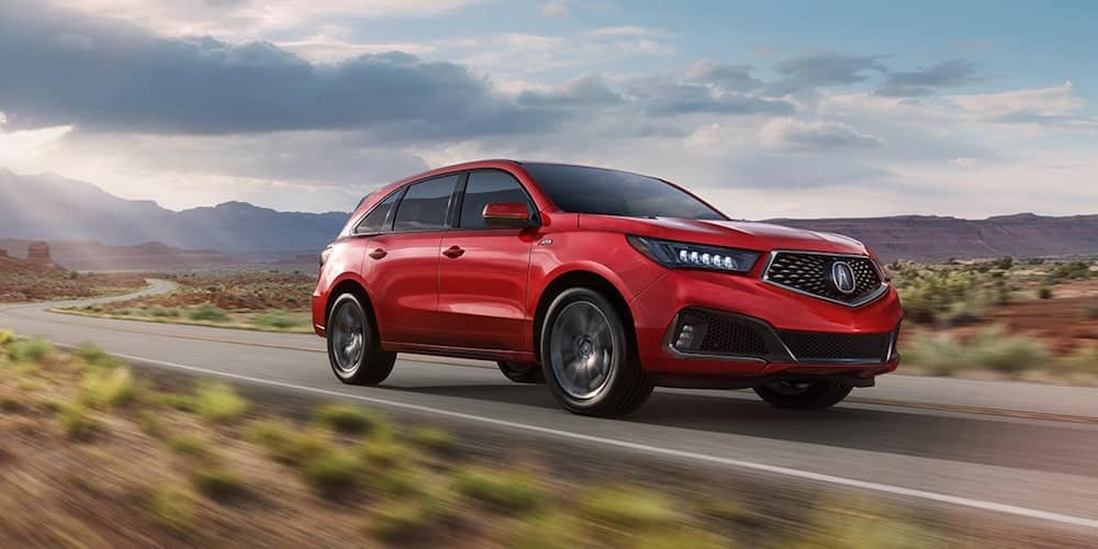 Red 2020 Acura MDX on Open Highway