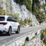 White 2020 Acura MDX on Highway Near Water