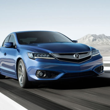 Blue ILX driving past mountains