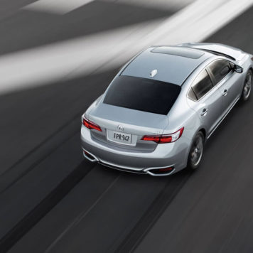 Silver ILX driving on road