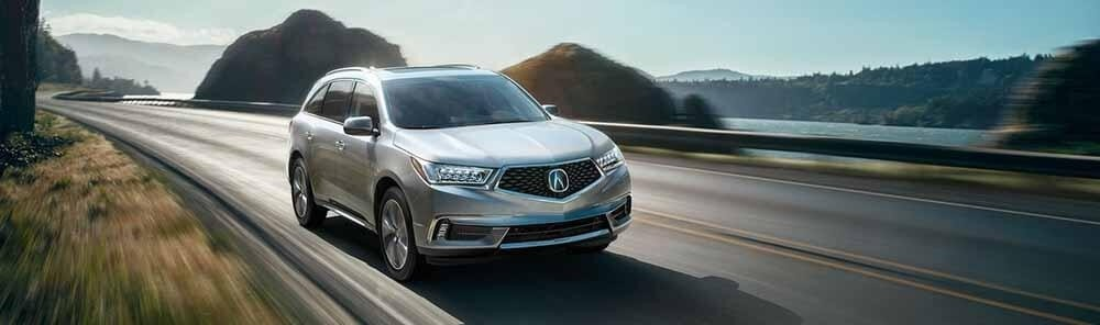 Acura MDX driving near the ocean