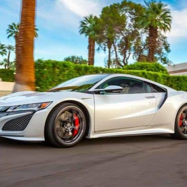 2018 Acura NSX Driving with Palm Trees in the Background