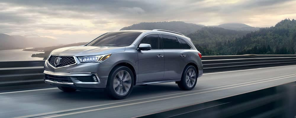 2019 Acura MDX Driving by a Lake