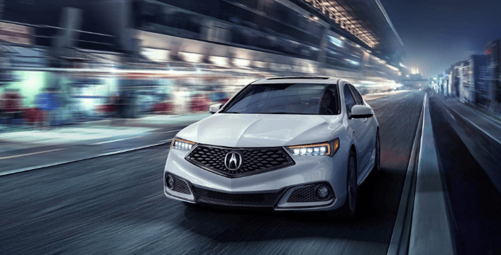 white 2019 Acura TLX driving in city