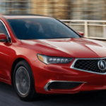 red 2019 Acura TLX driving fast