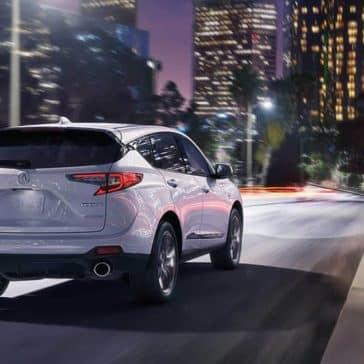 2020 Acura RDX driving on city street at night