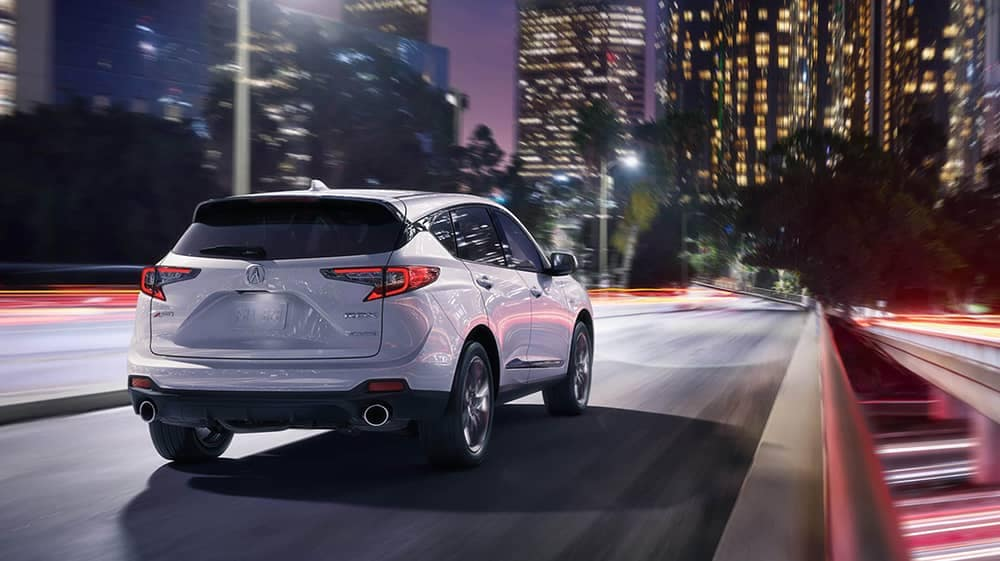 2020 Acura RDX driving on city street at night