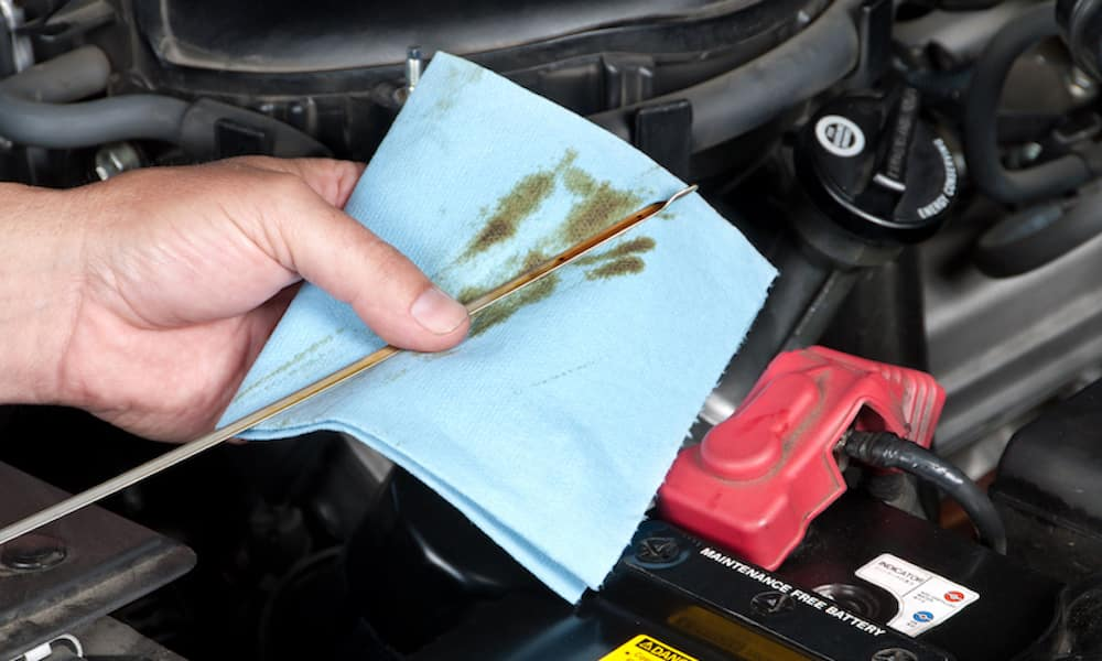 Mechanic Wiping Oil off Dipstick
