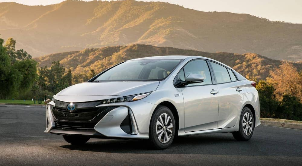 A silver 2017 Toyota Prius Premium, popular among used cars for sale, is in front of mountains.