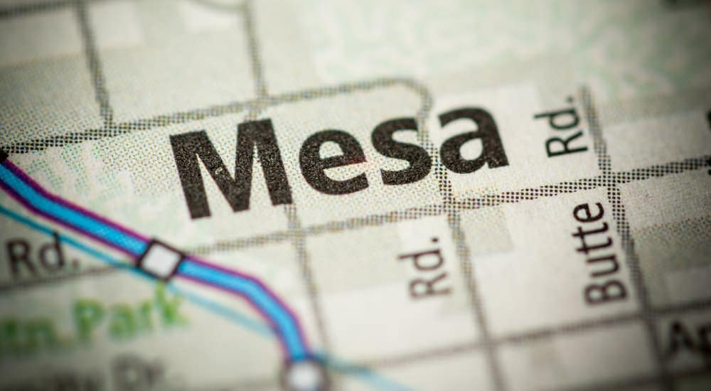 A paper map of the Mesa, Arizona area is shown.