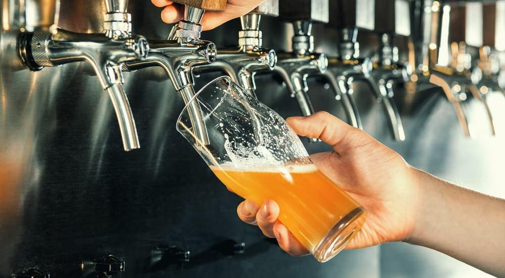 Beer is being poured from a tap.