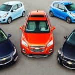 Five small 2014 Chevy cars are shown from a high angle.