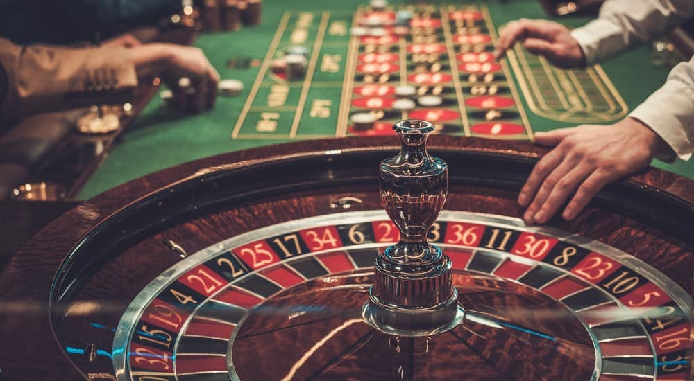 People are shown playing games at the casino.