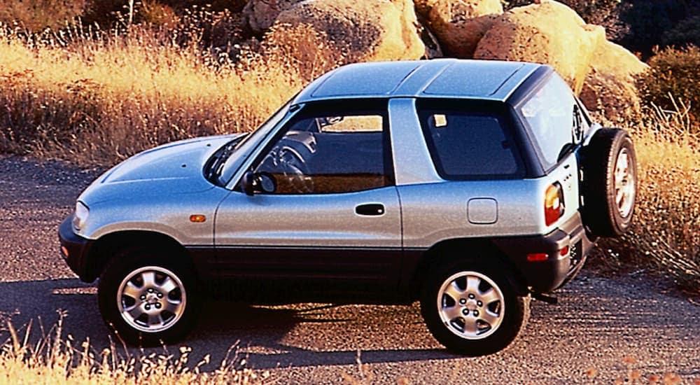 A silver 1998 two door Toyota RAV4 is perked on a sunny desert road near Mesa, AZ.