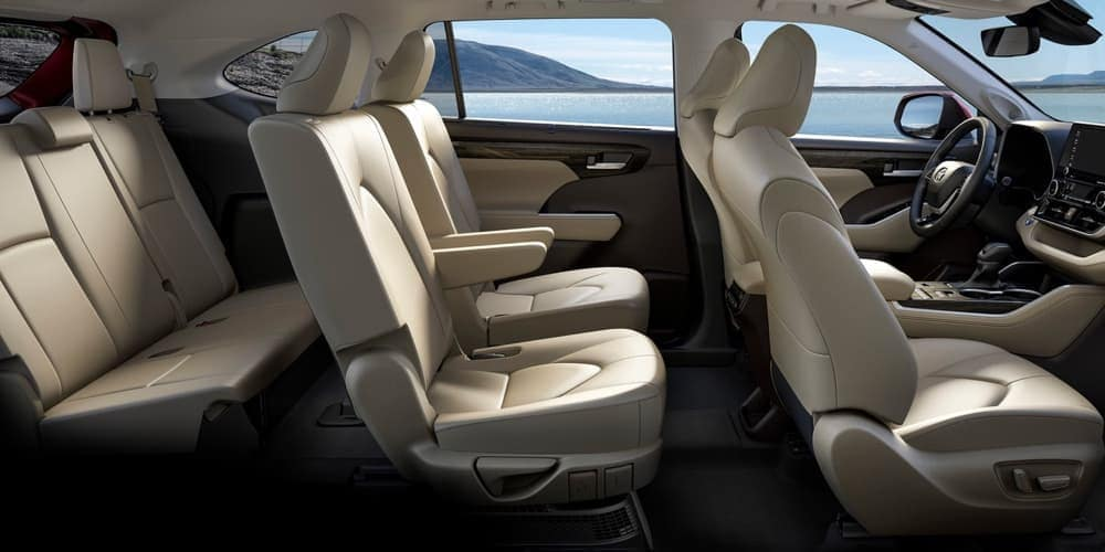 Inside of 2020 Toyota Highlander with tan seats at sun outside