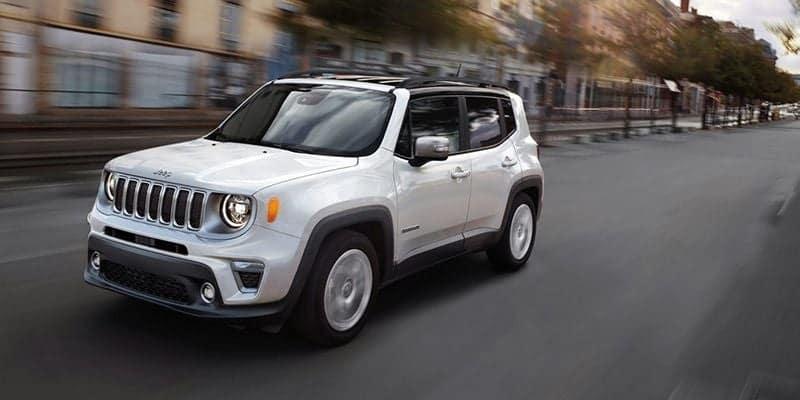 White 2020 Jeep Renegade cruising down the street