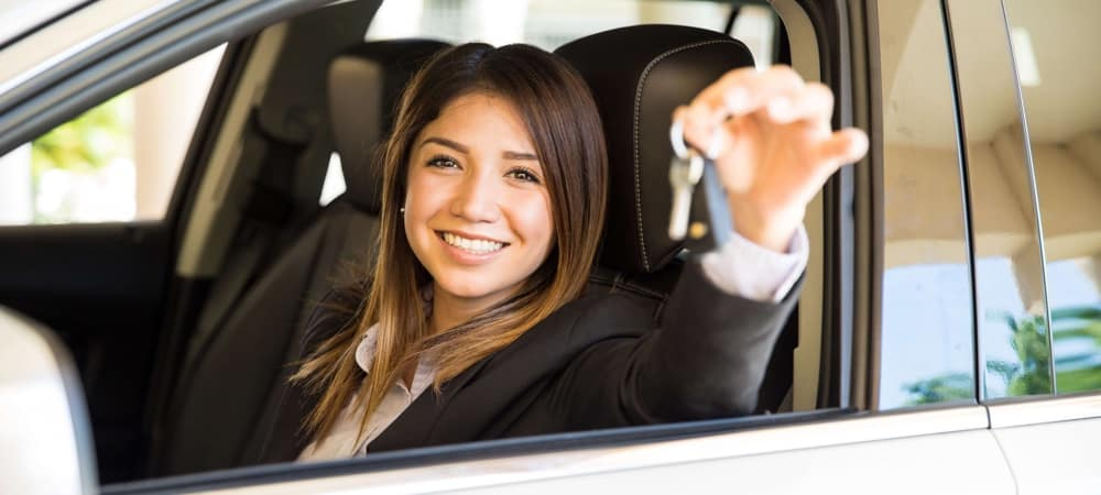 Woman holding the keys in a car