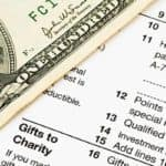 Tax Form and Hundred Dollars
