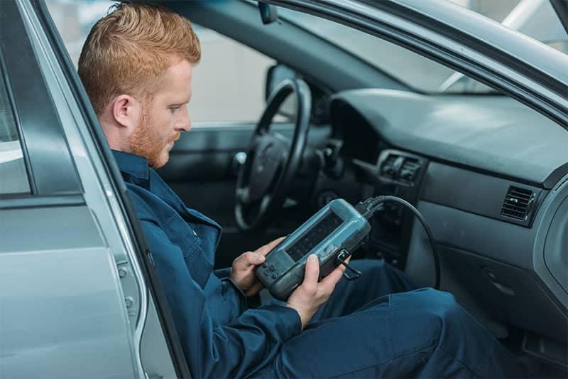 Savvy mechanic checks Diagnostic Codes