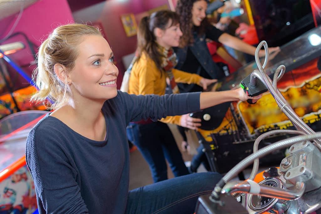 Women in pinball arcade
