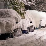 Cars Covered in Snow on the Side of the Road