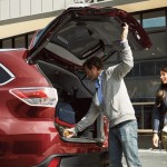 Man opening Toyota Highlander trunk