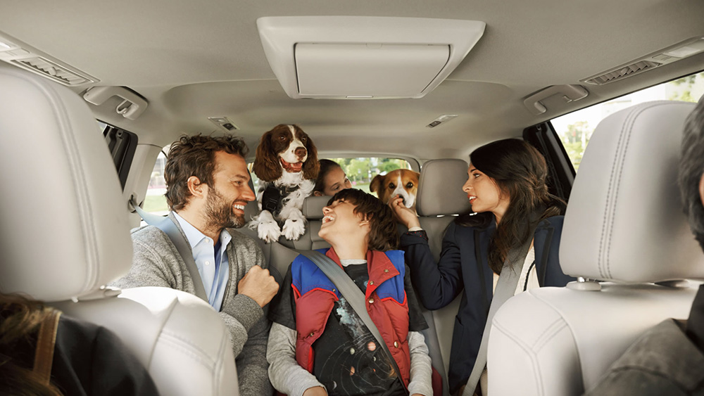Family inside Toyota Highlander