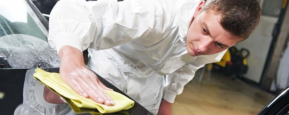 Mechanic repairing and polishing car