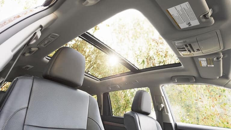 Sun shining through Toyota Highlander sunroof