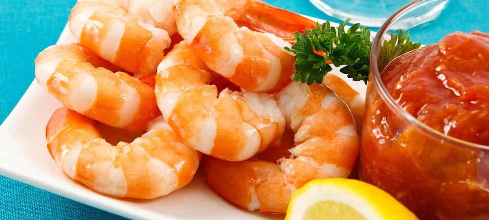 Fresh shrimp on an aqua background