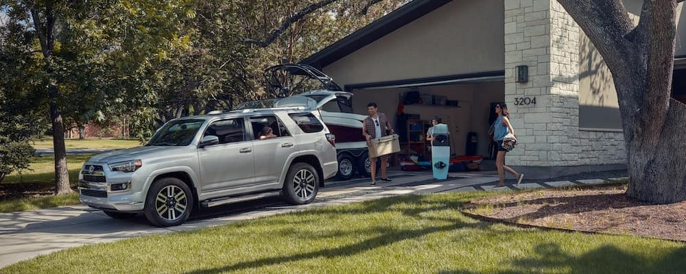 Dad loading trunk of silver Toyota 4Runner