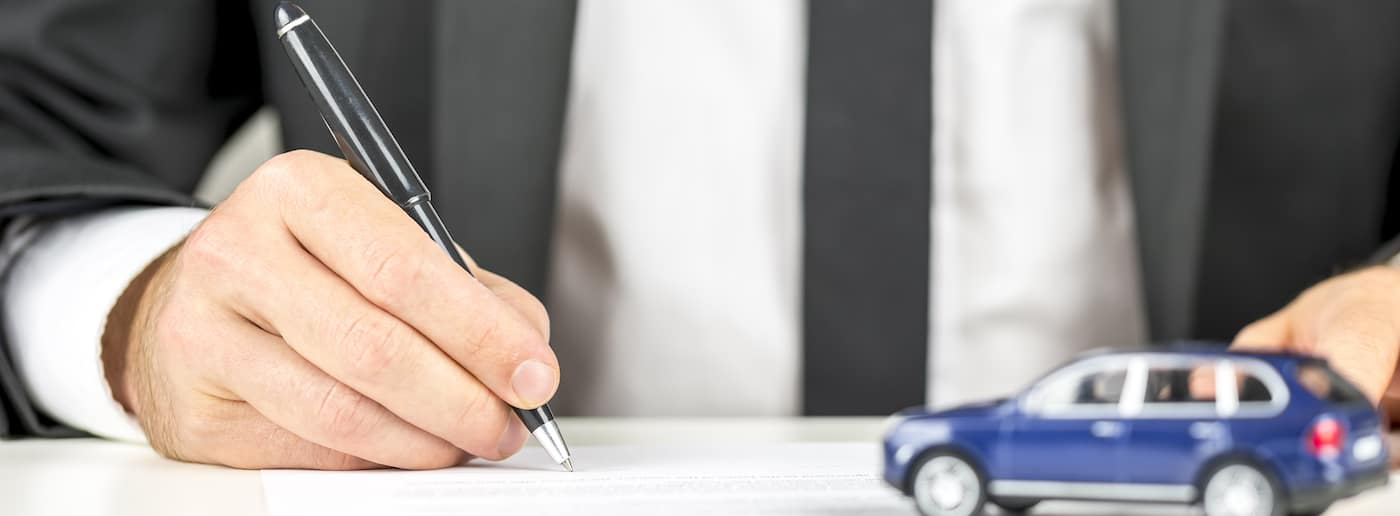 Man filling out insurance form
