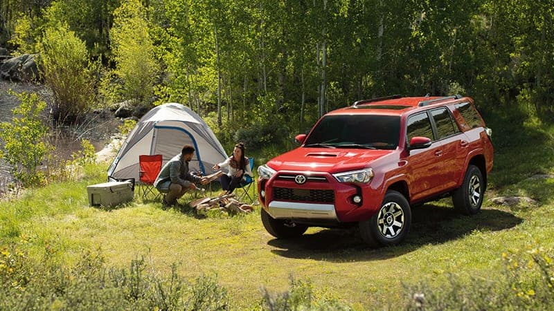 4Runner parked next to a tent and campsite