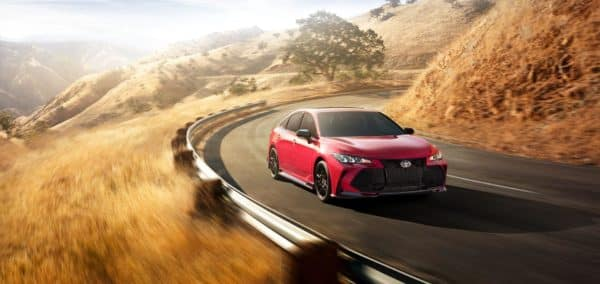 A Toyota driving around a curve