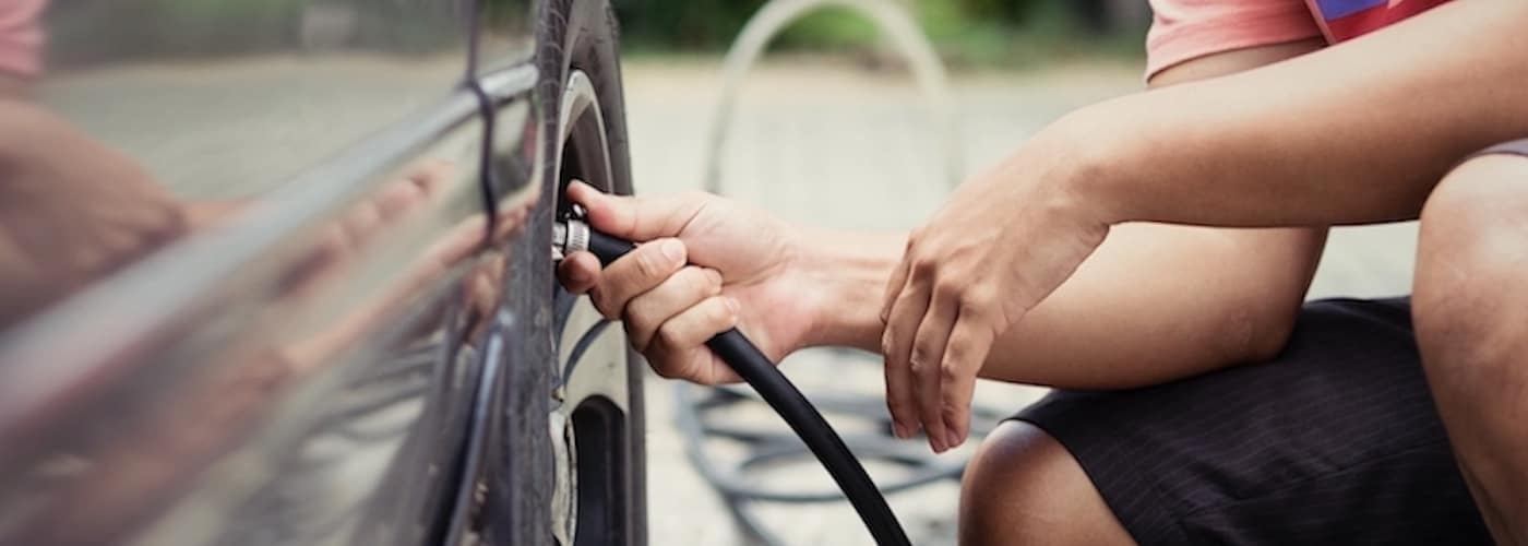 Man filling up tire