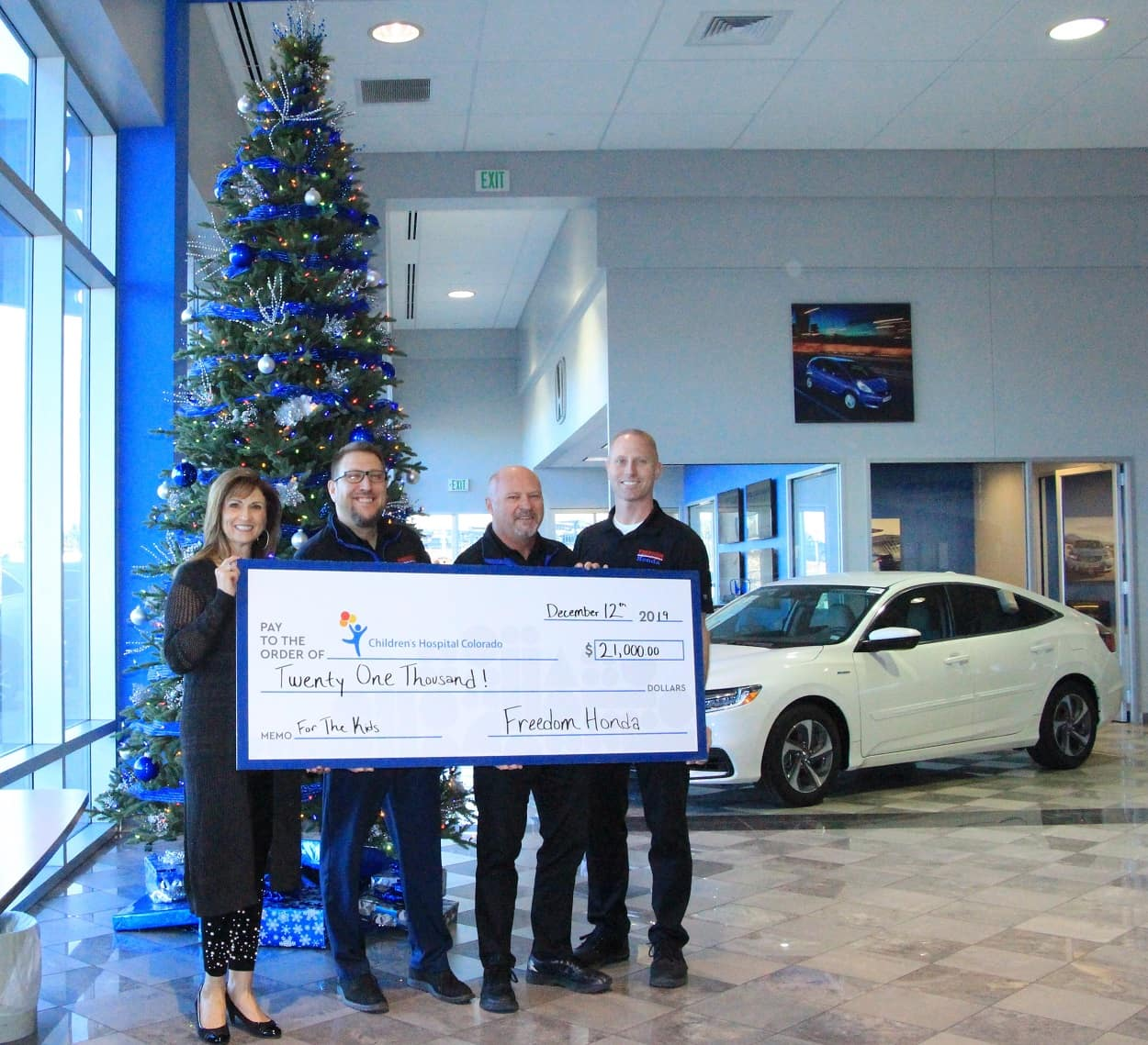 2019 Freedom Honda Giant Check Donation to PMHI in Front of Christmas Tree
