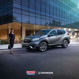 A woman approaching a Honda CR-V