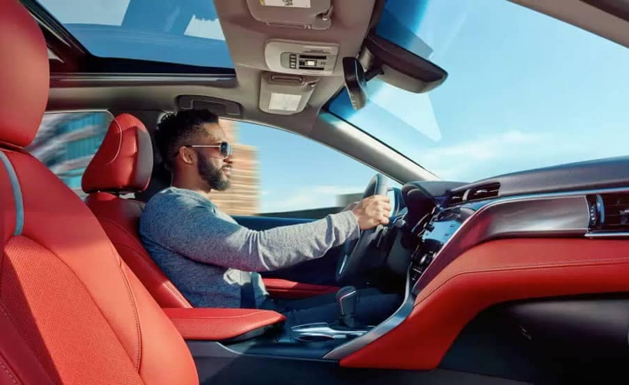man in drivers seat of 2018 Toyota Camry