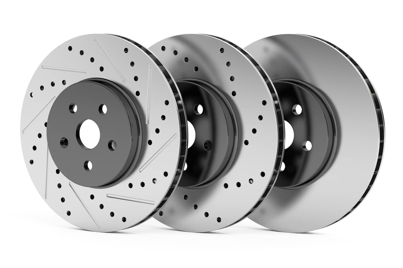 A close up shot of car disc brakes and rotors