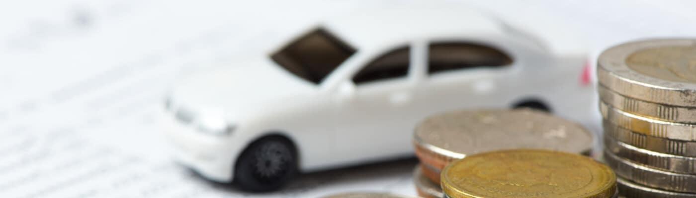 car finance paperwork with tiny car