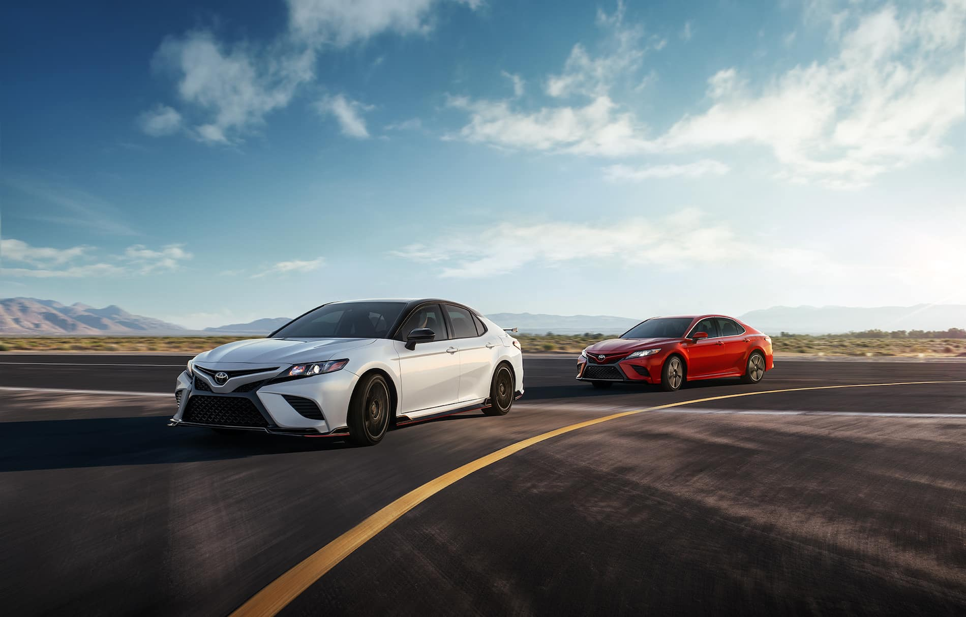 Model Features of the 2020 Toyota Camry at Glen Toyota | two 2020 camry parked on the street