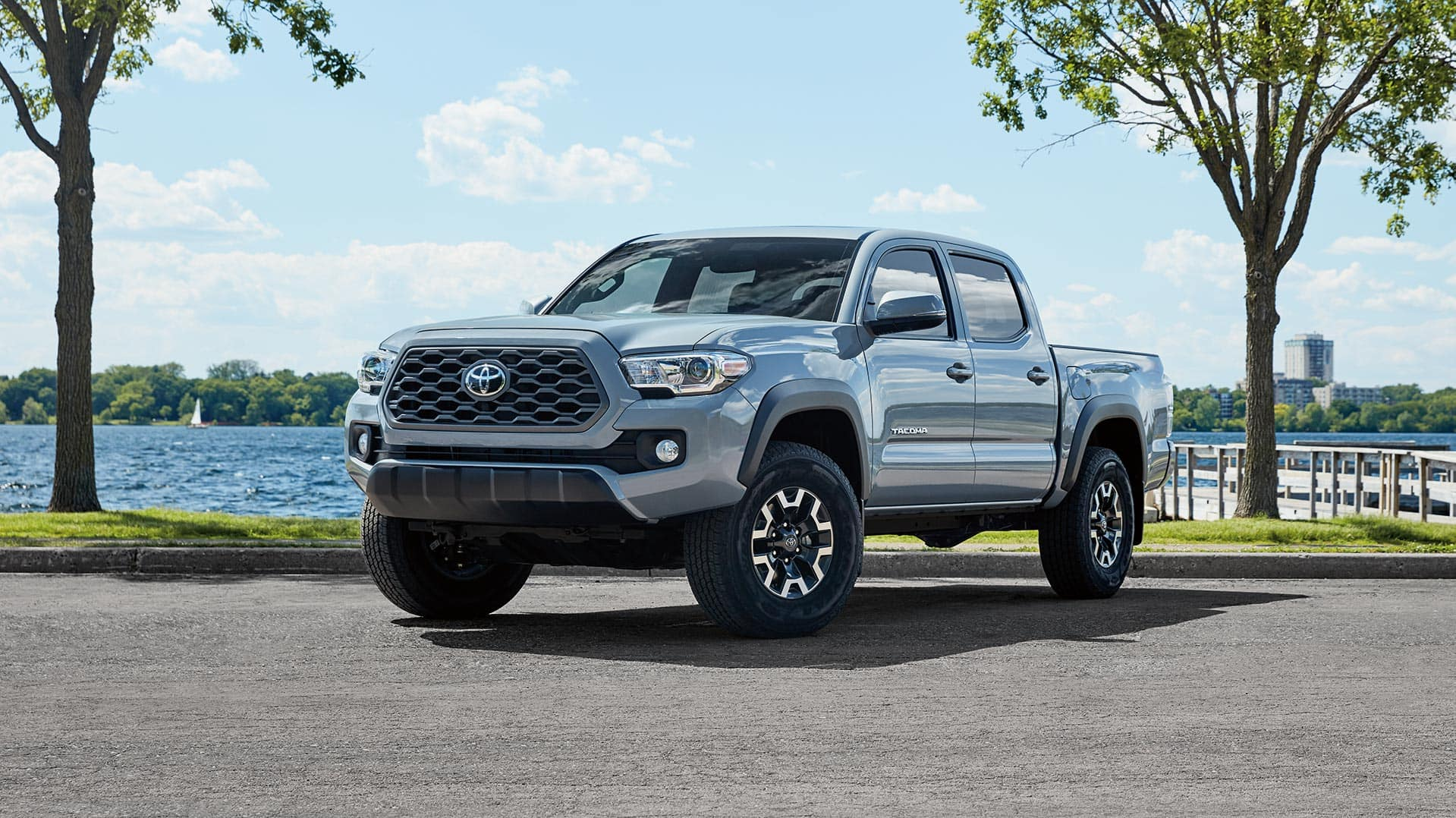 Glen Toyota is a Toyota Dealership in Fair Lawn near Glen Rock NJ | Grey MY20 Tacoma Parked in front of Water