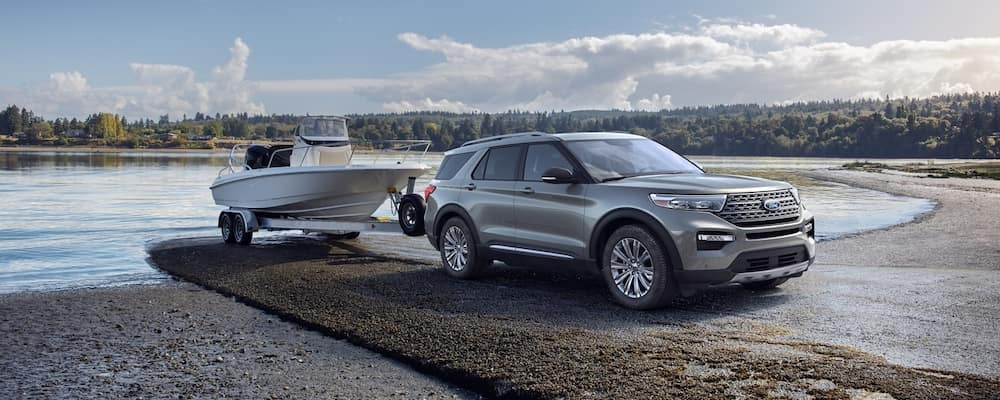 Silver 2020 Ford Explorer towing boat out of lake
