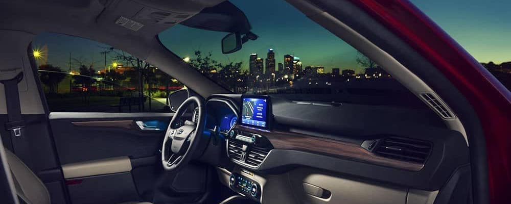 2020 Ford Escape inside view of dashboard with city skyline in background at night