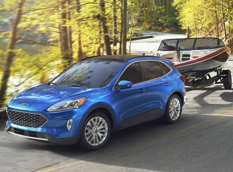 2020 Blue Ford Escape towing Boat