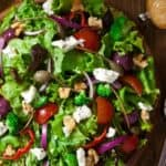 A colorful spring salad on rustic wood table - Graff Chevrolet in Grand Prairie, Texas