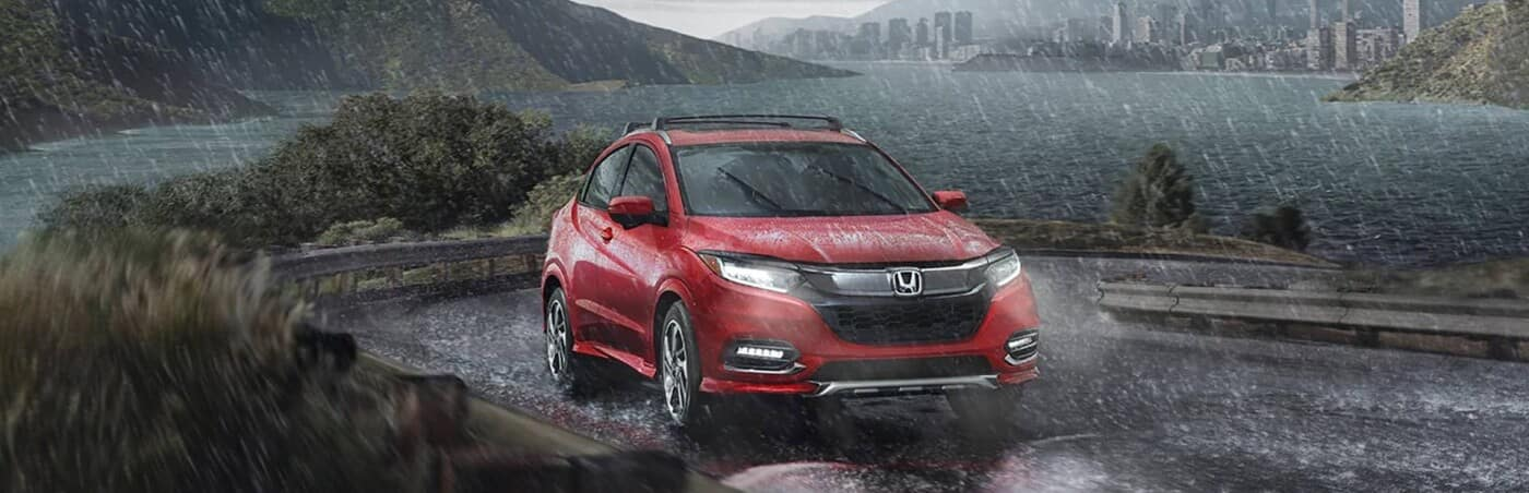 A 2020 Honda HR-V with AWD driving in the rain