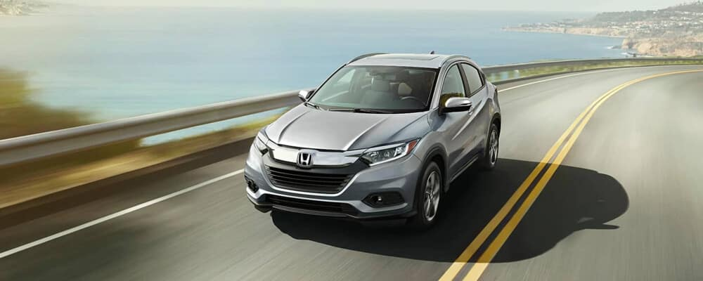 A 2020 Honda HR-V driving on a highway along the coast